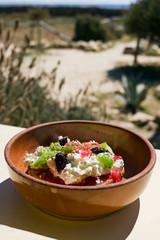 Dakos greek appetizer, dried bread, tomatoes, feta, or mizithra cheese, capers, oregano. Taken in Donoussa Island, Greece