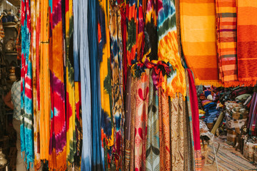 Textile shop in a moroccan market, with  scarfs and tunicas in a lot of colors.