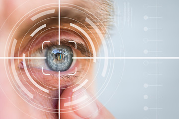 Eye monitoring and treatment in healthcare. Biometric scan of the male eye.