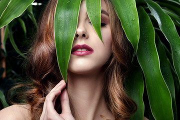 beautiful girl and green leaves Wall mural
