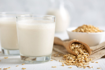 Oat milk. Healthy vegan non-dairy organic drink with flakes