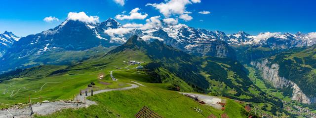Fotobehang Alpen Hiking trail to summit of mountain Mannlichen, popular viewpoint in Swiss Alps, Switzerland. Eiger, Monch and Jungfrau, Lauterbrunnen in background.