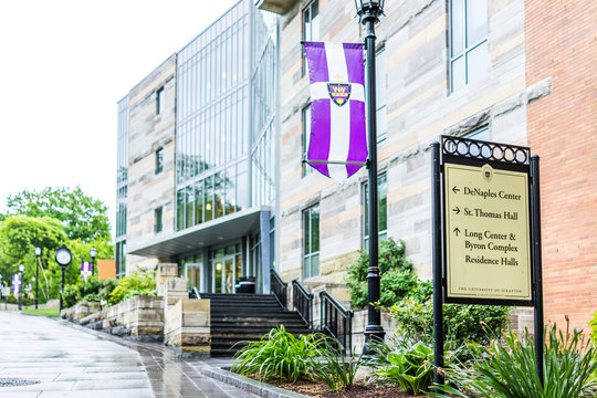 Scranton, USA - May 25, 2017: University of Scranton purple flag and building with sign stating directions