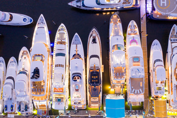 Ariel direct overhead shot of luxury Super yachts lit at night Fort Lauderdale international boat show