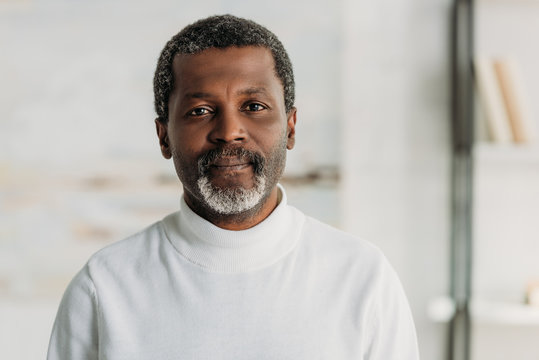 senior, confident african american man looking at camera