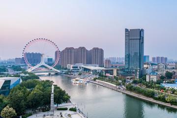 Twilight scenery of Haihe River and Ferris wheel in Tianjin, China Papier Peint