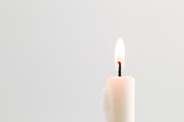 white candle flame on black background