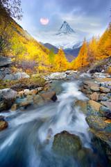 Wall Mural - Matterhorn over a mountain stream in autumn
