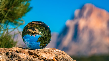 Crystal ball alpine evening landscape shot at the famous Seiser Alm, South Tyrol, Italy