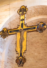Wooden medieval crucifix painted in gold