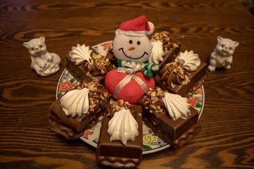 Canvas Prints Fairytale World Chocolate cake made from natural ingredients with a snowman, and souvenirs for the New Year and any holiday