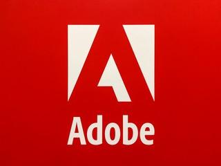 White Adobe Logo on Red Background