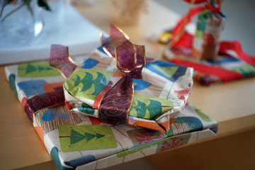 Christmas presents laying on wooden table