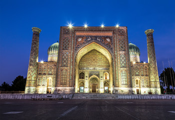 Sherdor madrasah on Registan square in Samarkand at night, Uzbekistan