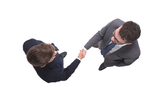 top view. business people shaking hands. isolated on white
