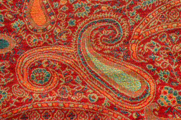 Red and blue indian floral paisley pattern closeup and full frame. Design for textile, cover, backdrop, fabric