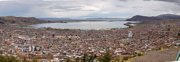 Aerial panoramic view of Puno city with the Titicaca lake in the background in Peru