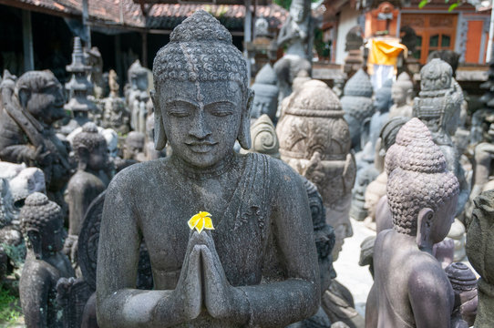Buddhist statue at stonemasons workshop Bali Indonesia