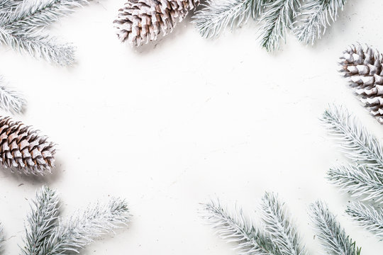 Christmas background with fir tree and decorations on white.