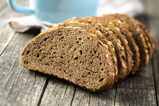 Sliced whole grain bread with oat flakes. Wholemeal bread.