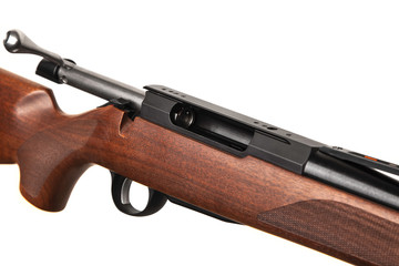 Modern bolt carbine isolated on white background. Close-up of a weapon with a wooden butt for hunting, sports and self-defense.