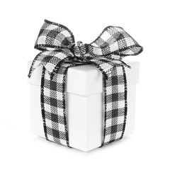 Photo sur Aluminium Buffalo White Christmas gift box with black and white buffalo plaid bow and ribbon. Side view isolated on a white background.