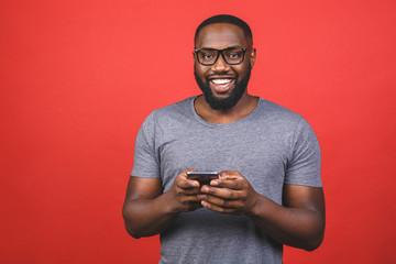 Portrait of handsome excited cheerful joyful delightful african american guy wearing casual sending...