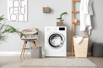 Interior of home laundry room with modern washing machine Fotomurales