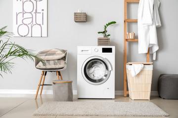 Obraz Interior of home laundry room with modern washing machine - fototapety do salonu