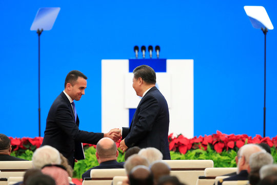 Italian Foreign Minister Luigi Di Maio shakes hands with Chinese President Xi Jinping following his speech at the opening ceremony of the second China International Import Expo (CIIE) in Shanghai