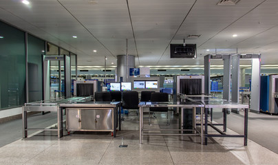 Checkpoint at the airport. X-ray scanner with monitors for detecting dangerous items of passengers.