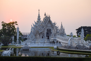 Wat Rong Khun Temple (White temple) during sunet at dusk in Chiangrai province, Thailand.