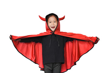 Happy laughing little Asian child girl dressed Halloween costume. Kid in Dracula robe isolated on white background. Wall mural