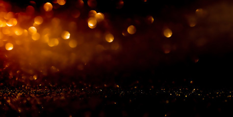 Twinkling golden glitter falling gold background