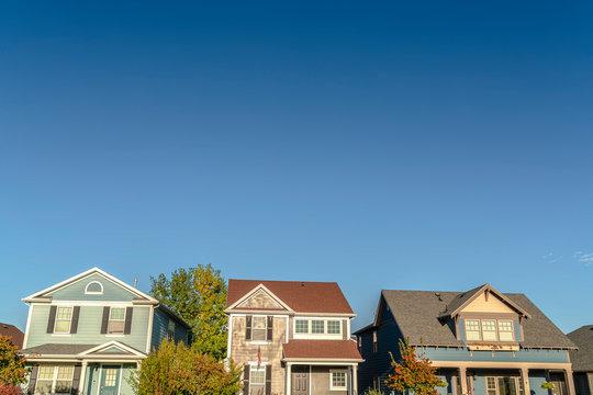 Row of three houses on a modern urban estate