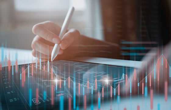 Stock exchange market concept, businessman trader looking on tablet with graphs analysis candle line in office room, diagrams on screen.