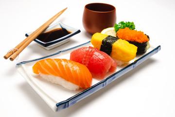 In de dag Sushi bar Sushi salmon & tuna sushi shrimp and wasabi on the white plate isolated.selective focus