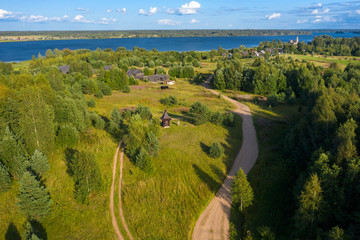 Aerial view from above of a  wayside cross and chapel. Tver region, Russia. On the way from Varangians to Greeks