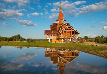 The Church of German Stolobensky in Sosnici on a summer evening at sunset. Built in the style of Novgorod wooden churches.