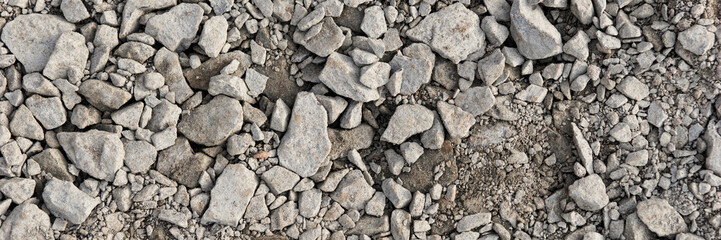 Panoramic image. Gray gravel stones for the underground in road construction Wall mural