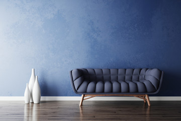 Blue sofa and white vases