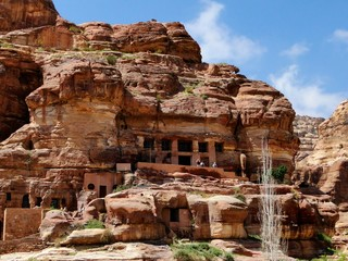 Natural colorful rock of cross section in Petra in Jordan, an UNESCO World Heritage Site. A historical archaeological park with caves, temples, and tombs reveal impressive civilization.