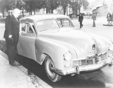 Henry Kaiser opens the door of the first Kaiser Special to come off assembly-line, May 31,1946