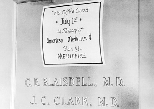 Doctor protesting the new Medicare program.The sign posted reads, 'This office Closed July 1st in memory of American Medicine, slain by Medicare'. Asbury Park, New Jersey