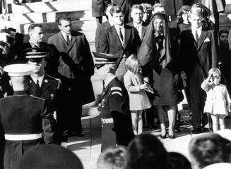 Three year old John F. Kennedy Jr. salutes his father's flag draped coffin after funeral mass