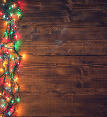 Empty rustic wooden background with Christmas lights