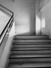 The image of stairs up a building, an office building, meaning the same place that has to work or a place that has been in the past
