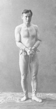 Harry Houdini (1874-1926), in chains. Ca. 1900
