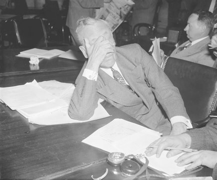 Alfred P. Sloan 1875-1966 chairman of General Motors covered his face with his hand during his