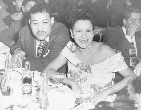 Heavyweight champ Joe Louis and his first wife Marva dining at a night club in 1947